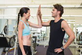 Fit man and woman high fiving — Stock Photo