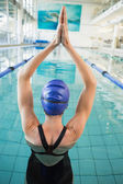 Swimmer in the pool with arms raised — Stock Photo