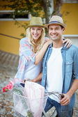Hip couple going for a bike ride — ストック写真