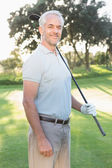 Handsome golfer looking at camera — Foto Stock