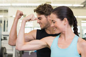 Fit attractive couple comparing biceps — Photo