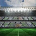 Large football stadium under spotlights — Stock Photo