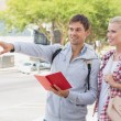 Tourist couple consulting the guide book — Stock Photo #48340531