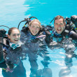Friends on scuba training in swimming pool — Stock Photo #48340533