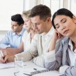 Businesswoman falling asleep during meeting — Stock Photo