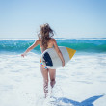 Surfer girl running to sea — Stock Photo #48340587