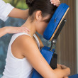 Brunette getting a massage in chair — Stock Photo #48341481