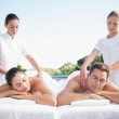 Couple enjoying couples massage poolside — Stock Photo #48341821