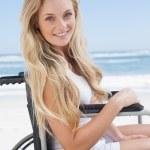Wheelchair bound blonde smiling on beach — Stock Photo #48342327