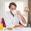 Man in bathrobe drinking coffee — Stock Photo #48342623