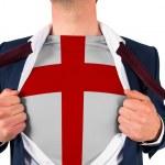 Businessman opening shirt to reveal england flag — Stock Photo