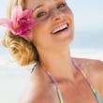 Blonde in bikini smiling on beach — Stock Photo #48343259