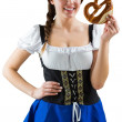 Pretty oktoberfest girl holding pretzel — Stock Photo #48343343
