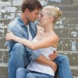 Couple sitting on steps showing affection — Stock Photo #48344071