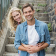 Hip couple sitting on steps — Stock Photo