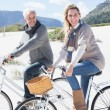 Couple going on a bike ride on the beach — Stock Photo #48344221