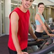 Man and woman on the treadmills — Stock Photo