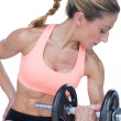 Woman doing bicep curl with dumbbell — Stock Photo #48344609