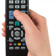 Hand holding remote control — Stock Photo #48344965