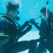 Man proposing marriage to girlfriend underwater — Stock Photo #48345581