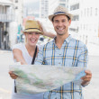 Tourist couple consulting the map — Stock Photo