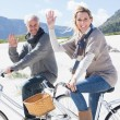 Couple going on a bike ride on the beach — Stock Photo #48346065