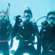 Friends on scuba training submerged in pool — Stock Photo #48346425