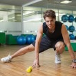 Fit man warming up in fitness studio — Stock Photo #48346631
