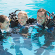 Friends on scuba training in swimming pool — Stock Photo #48346647