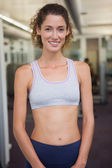 Fit woman smiling at camera — Stock Photo