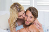 Couple hugging on couch — Stock Photo