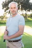 Smiling handsome golfer — Stock Photo