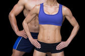 Crossfit couple with hands on hips — Stock Photo