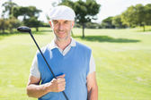 Cheerful golfer smiling at camera — Stok fotoğraf