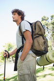 Handsome hiker holding walking pole — Foto Stock
