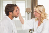 Couple in bathrobes — Stock Photo