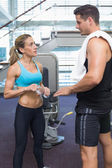 Bodybuilding man and woman at the gym — Stock Photo