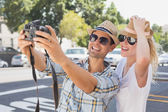 Young hip couple taking a selfie — Stock Photo