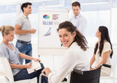 Businesswoman in wheelchai during meeting — Stock Photo