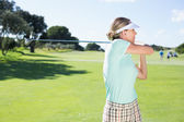 Lady golfer teeing off for the day — Stock Photo