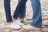 Couple in jeans standing on path — Stock Photo