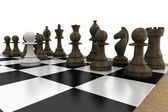 Black chess pieces on board with white pawn — Stock Photo