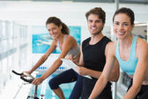 Women in a spin class with trainer — Stock Photo