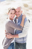 Hugging couple on the beach — Stock Photo