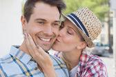 Woman kissing mans cheek — Stock Photo