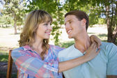 Couple sitting on bench in the park — Stock Photo