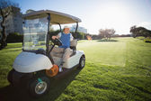 Golfer reversing his golf buggy — Stock Photo