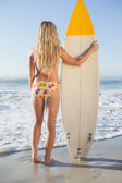 Blonde surfer in holding board — Stock Photo