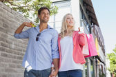 Stylish couple walking with shopping bags — Foto Stock