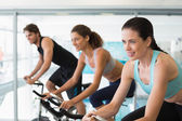Fit people in a spin class — Stock Photo